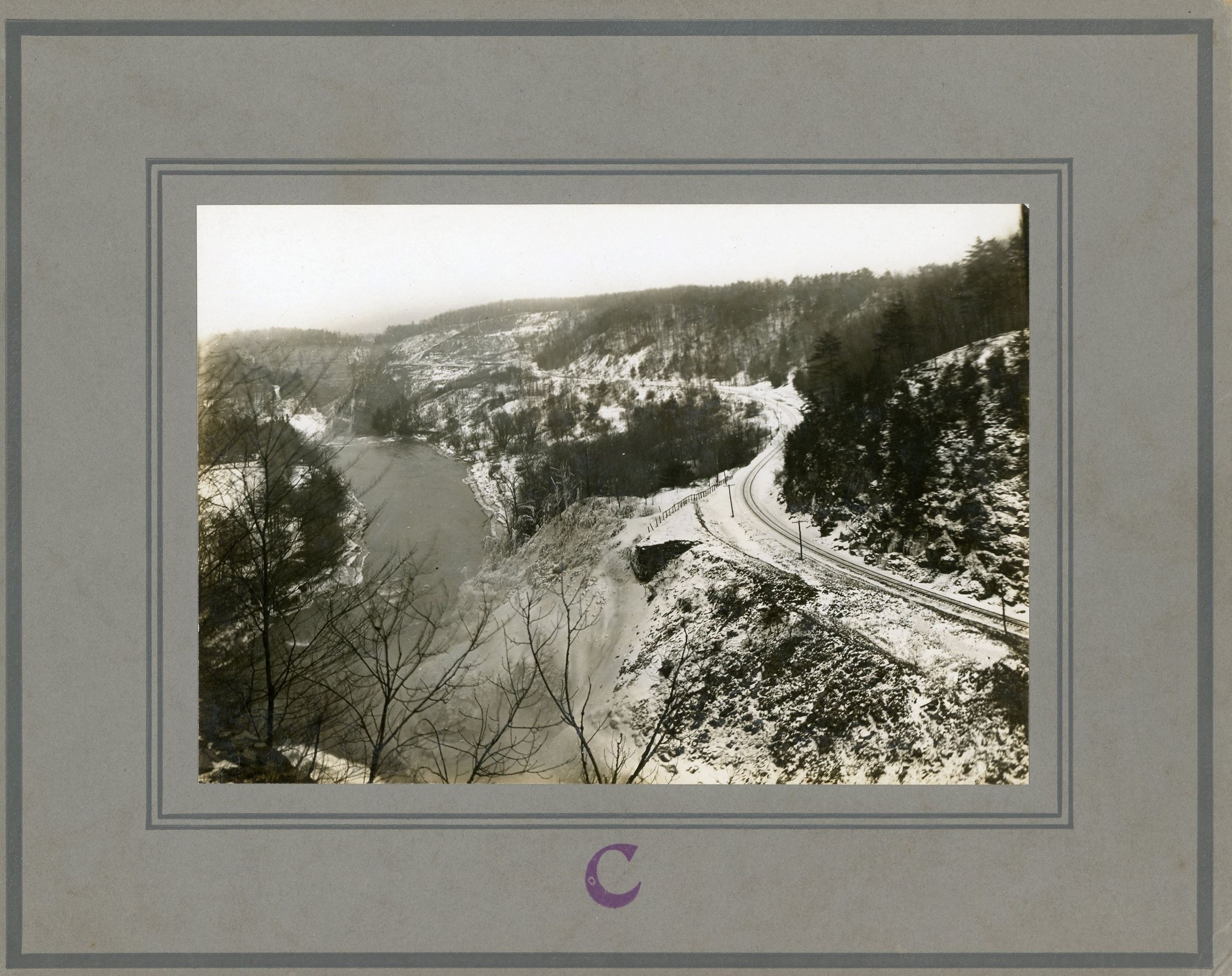 Image of railraod tracks winding along gorge in Letchworth state Park
