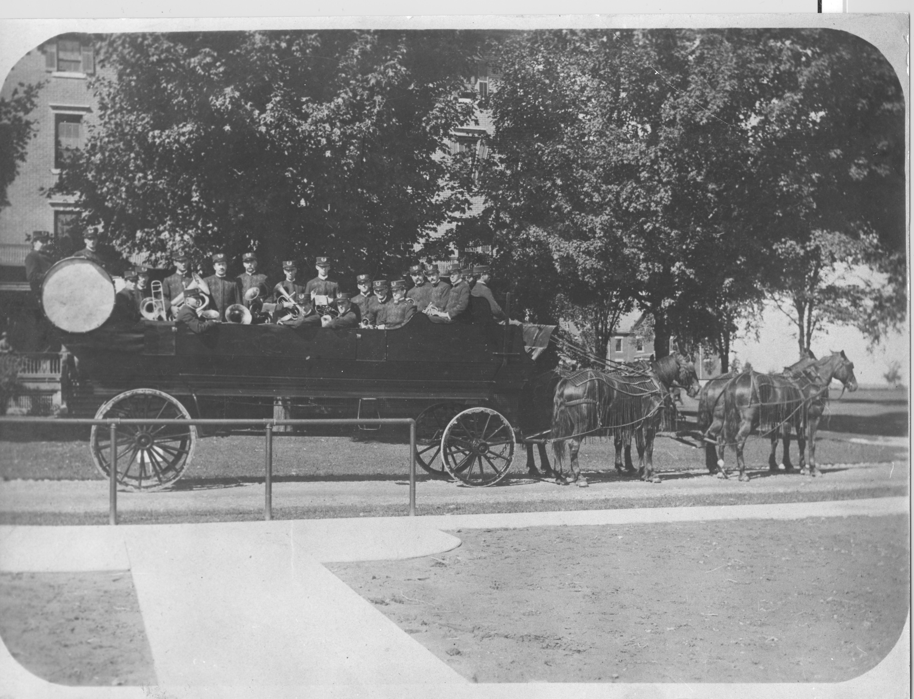 Image of large wooden horse-drawn wagon with musicians in it at Craig Colony