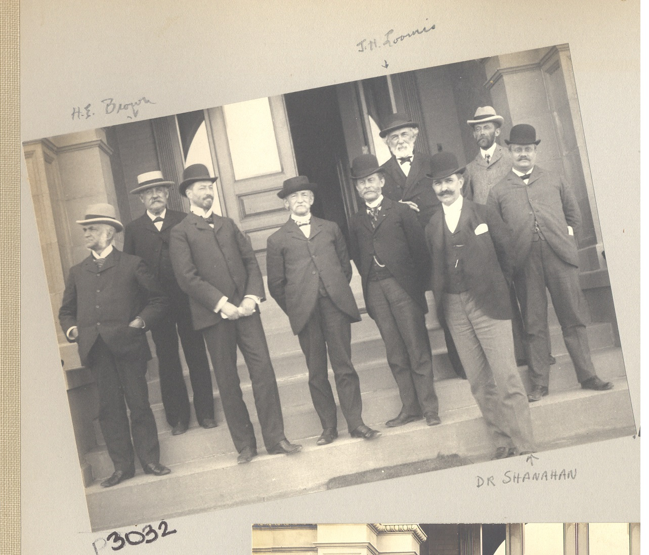 Image of William T. Shananhan and other men on steps of building at Craig Colony