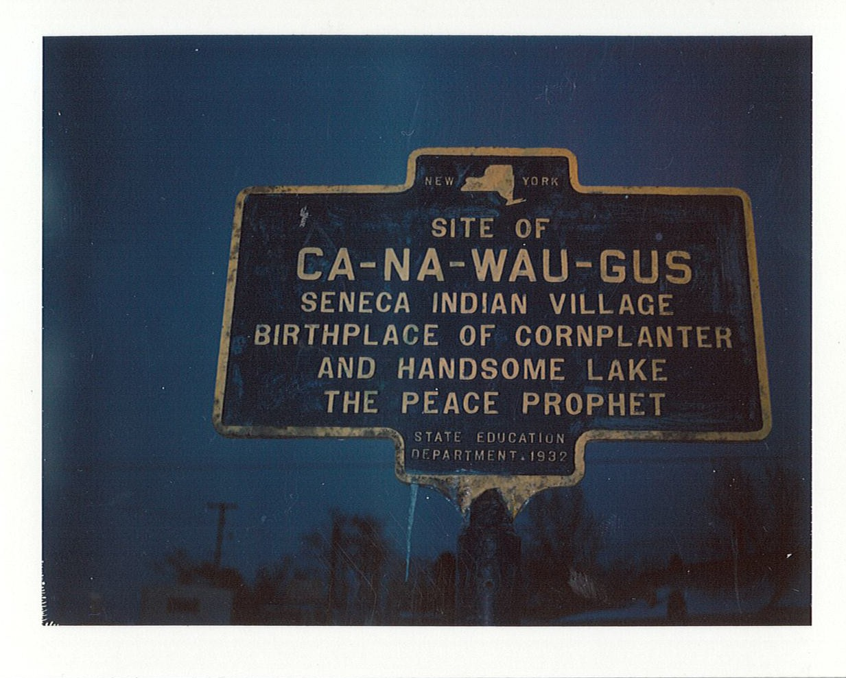 Image of blue and yellow historical marker for Ca-na-wau-gus