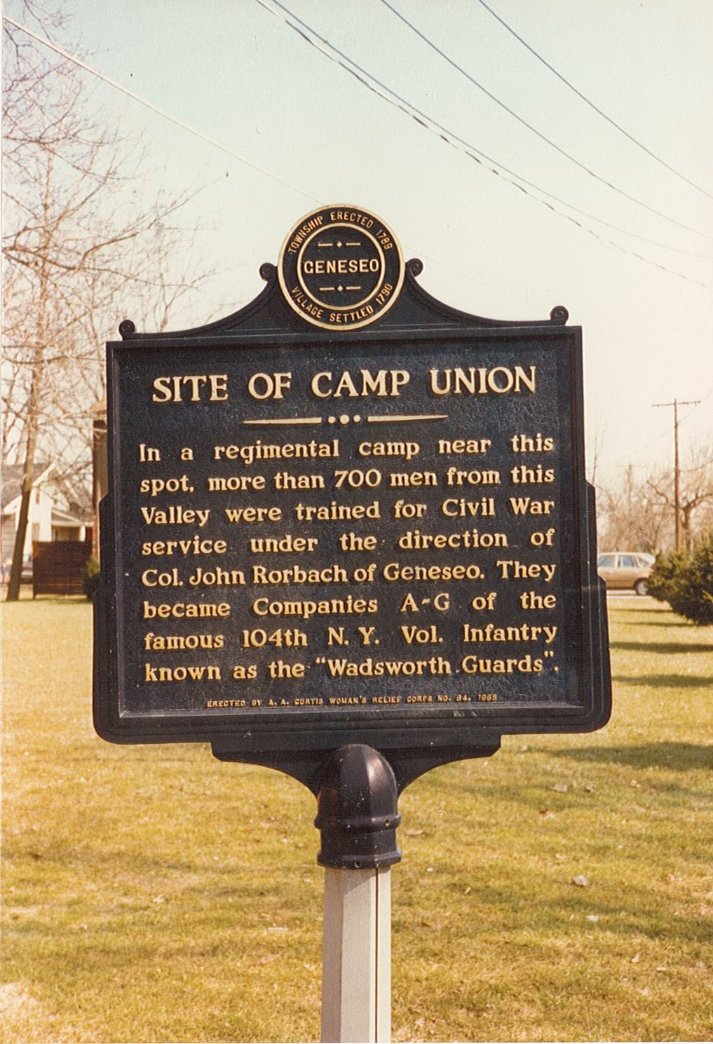 Image of blue and yellow historical marker sign for Cap Union