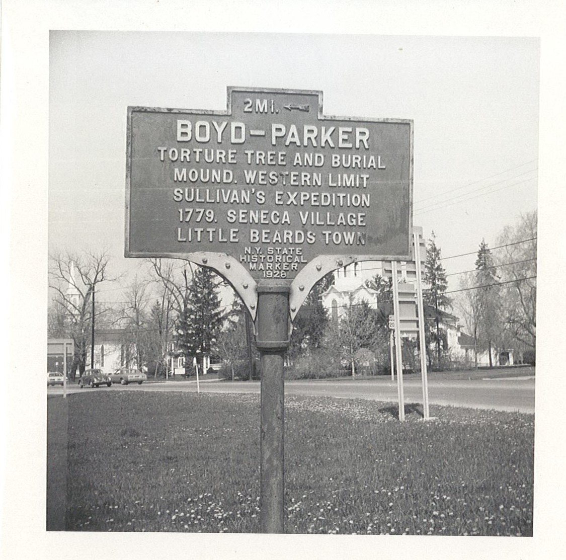 Image of blue and yellow historical marker sign for Boyd and Parker memorial site