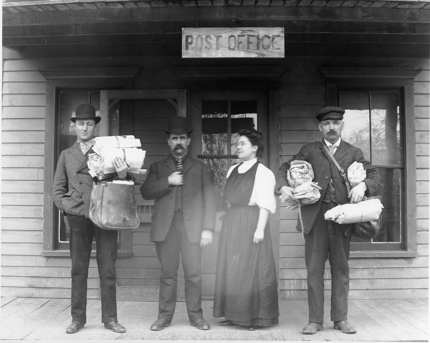 Images of people on porch of post office